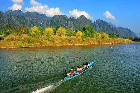 nam: Motorboat moving on Nam Song River in Vang Vieng, Laos. Vang Vieng is a popular destination for adventure tourism in a limestone karst landscape.