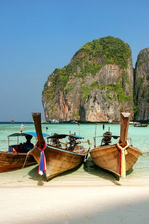 Longtail boats anchored at Maya Bay on Phi Phi Leh Island, Krabi Province, Thailand. It is part of Mu Ko Phi Phi National Park. Stock Photo