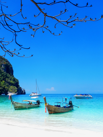 Longtail boats anchored at Ao Yongkasem beach on Phi Phi Don Island, Krabi Province, Thailand. Koh Phi Phi Don is part of a marine national park.