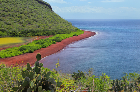 View of red beach and lagoon of Rabida Island, Galapagos National Park, Ecuador