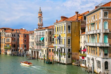 Colorful buildings along Grand Canal in Venice, Italy. Venice is situated across a group of 117 small islands that are separated by canals and linked by bridges.