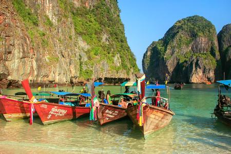 Longtail boats anchored at Maya Bay on Phi Phi Leh Island, Krabi Province, Thailand. It is part of Mu Ko Phi Phi National Park. Editorial