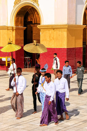 Local people in traditional costumes taking part in wedding ceremony at Mahamuni Pagoda, Mandalay, Myanmar. Mahamuni Pagoda is a Buddhist temple and major pilgrimage site in Myanmar.