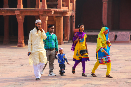 fatehpur sikri: Visitors walking in Fatehpur Sikri complex in Uttar Pradesh, India. Fatehpur Sikri is one of the best preserved examples of Mughal architecture in India.