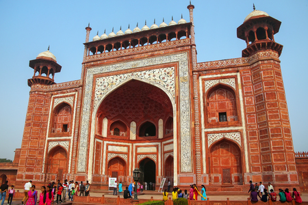 Tourists standing near Darwaza-i-Rauza (Great Gate) in Chowk-i Jilo Khana courtyard, Taj Mahal complex, Agra, India. The gate is the main entrance to the tomb. Editorial