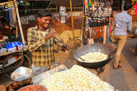 Young man popping popcorn at Kinari Bazaar in Agra, Uttar Pradesh, India. Agra is one of the most populous cities in Uttar Pradesh Editorial