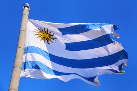 National flag of Uruguay flying in blue sky, Montevideo