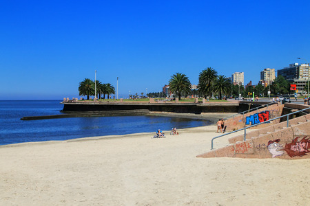 Sandy beach along the bank of the Rio de la Plata in Montevideo, Uruguay. Montevideo is the capital and the largest city of Uruguay
