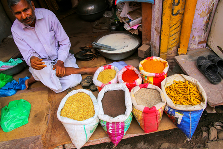 Local man selling spices at the street market in Fatehpur Sikri, Uttar Pradesh, India. The city was founded in 1569 by the Mughal Emperor Akbar, and served as the capital of the Mughal Empire from 1571 to 1585