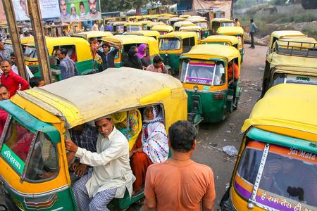 Local people sitting in a tuk-tuk at Kinari Bazaar in Agra, Uttar Pradesh, India. Agra is one of the most populous cities in Uttar Pradesh Editorial