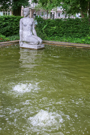 Small pool with fountains in the park near train station, Wiesbaden, Hesse, Germany. Wiesbaden is one of the oldest spa towns in Europe Stock Photo