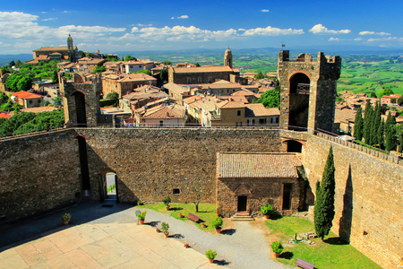 Fortress and town of Montalcino in Val dOrcia, Tuscany, Italy. The fortress was built in 1361 atop the highest point of the town.