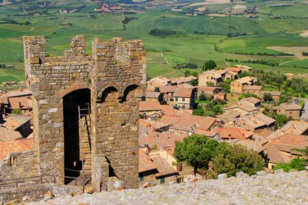 Tower of Montalcino Fortress and town rooftops in Val dOrcia, Tuscany, Italy. Stock Photo