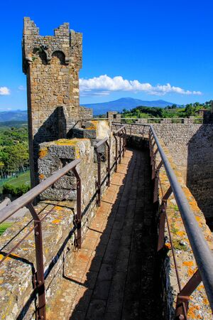 Tower and wall of Montalcino Fortress in Val dOrcia, Tuscany, Italy. Stock Photo