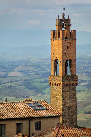 Clock tower of Palazzo dei Priori in Montalcino, Val dOrcia, Tuscany, Italy.