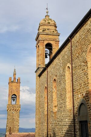 SantAgostino Church and bell tower of Palazzo dei Priori in Montalcino town, Val dOrcia, Tuscany, Italy.