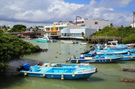 Boats anchored at Puerto Ayora on Santa Cruz Island, Galapagos National Park, Ecuador.
