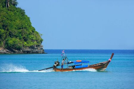 Longtail boat going from Phi Phi Don Island in Krabi Province, Thailand. Koh Phi Phi Don is part of a marine national park.