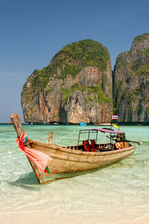 Longtail boat anchored at Maya Bay on Phi Phi Leh Island, Krabi Province, Thailand. It is part of Mu Ko Phi Phi National Park.