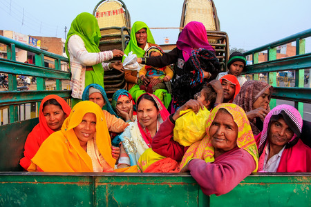 mughal empire: Group of local women sitting in the back of a truck in Fatehpur Sikri, Uttar Pradesh, India. The city was founded in 1569 by the Mughal Emperor Akbar, and served as the capital of the Mughal Empire from 1571 to 1585 Editorial