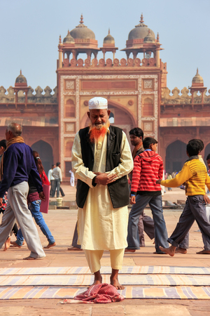 Local man standing in the courtyard of Jama Masjid in Fatehpur Sikri, Uttar Pradesh, India. The mosque was built in 1648 by Emperor Shah Jahan and dedicated to his daughter  Jahanara Begum