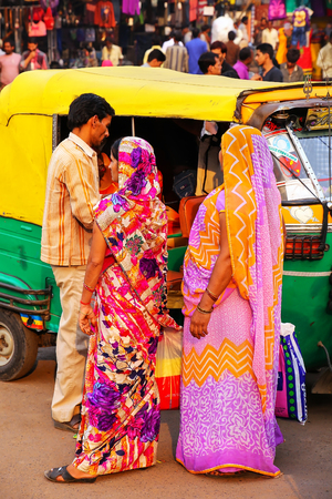 Local people waiting for a tuk-tuk at Kinari Bazaar in Agra, Uttar Pradesh, India. Agra is one of the most populous cities in Uttar Pradesh Editorial