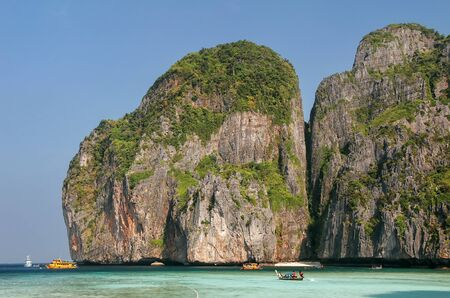 Maya Bay surrounded by limestone cliffs on Phi Phi Leh Island, Krabi Province, Thailand. It is part of Mu Ko Phi Phi National Park. Stock Photo