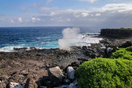 Coast of Espanola Island with blowholes in Galapagos National park, Ecuador.