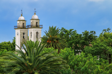 Bell towers of Basilica of the Holy Sacrament in Colonia del Sacramento, Uruguay. It is one of the oldest towns in Uruguay Stock Photo
