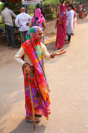 Old woman begging in the street of Fatehpur Sikri, Uttar Pradesh, India. The city was founded in 1569 by the Mughal Emperor Akbar, and served as the capital of the Mughal Empire from 1571 to 1585
