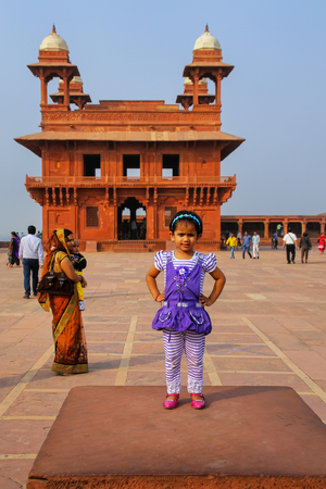 Small girl standing in Fatehpur Sikri complex in Uttar Pradesh, India. Fatehpur Sikri is one of the best preserved examples of Mughal architecture in India. Editorial