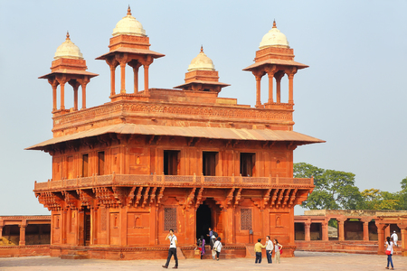 People walking around Diwan-i-Khas (Hall of Private Audience)  in Fatehpur Sikri, Uttar Pradesh, India. Fatehpur Sikri is one of the best preserved examples of Mughal architecture in India. Editorial