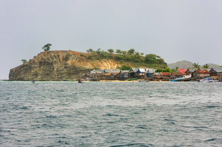 Small island with typical village in Komodo National Park, Nusa Tenggara, Indonesia. Komodo National Park is home to about 3500 people.