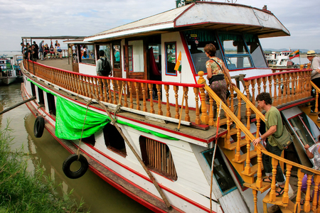People boarding tourist barge Ayeyarwady river port in Mandalay, Myanmar. Ayeyarwady river is the largest river in Myanmar. Editorial