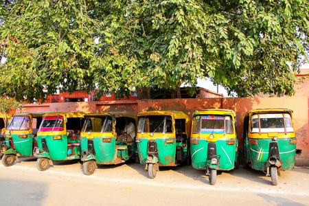 Tuk-tuks parked in Taj Ganj neighborhood of Agra, Uttar Pradesh, India. Agra is one of the most populous cities in Uttar Pradesh