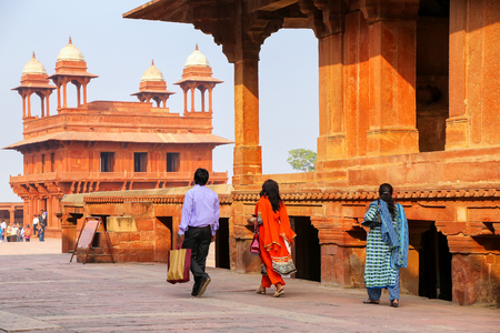 Tourists walking in Fatehpur Sikri complex in Uttar Pradesh, India. Fatehpur Sikri is one of the best preserved examples of Mughal architecture in India.