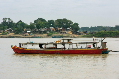 Wooden boats anchored on Ayeyarwady river near Mandalay, Myanmar. Ayeyarwady river is the largest river in Myanmar.