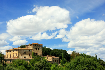 House surrounded by trees in Val d'Orcia, Tuscany, Italy.