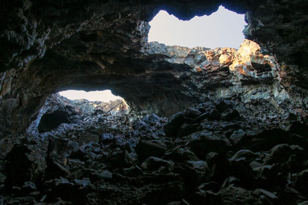 Indian Tunnel Cave in Craters of the Moon National Monument, Idaho, USA. The Monument represents one of the best-preserved flood basalt areas in the continental US. Фото со стока