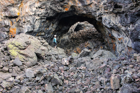 Indian Tunnel Cave in Craters of the Moon National Monument, Idaho, USA. The Monument represents one of the best-preserved flood basalt areas in the continental US. Banco de Imagens