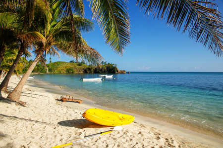 Sea kayak on the beach near palm trees, Nacula Island, Yasawas, Fiji