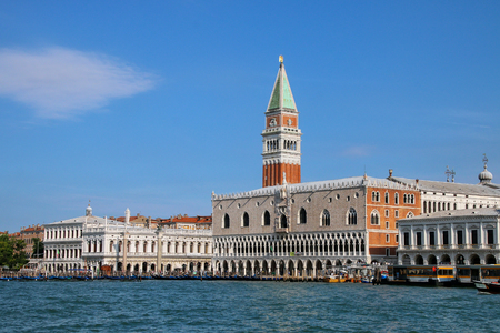 View of Piazza San Marco with Campanile, Palazzo Ducale and Biblioteca in Venice, Italy. These buildings are the most recognizable symbols of the city.