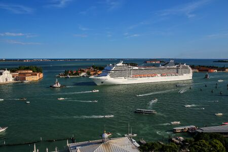 Cruise ship moving through San Marco canal in Venice, Italy. Venice is situated across a group of 117 small islands that are separated by canals and linked by bridges.