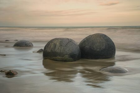 Moeraki Boulders at dusk on Koekohe Beach, Otago, South Island, New Zealand.