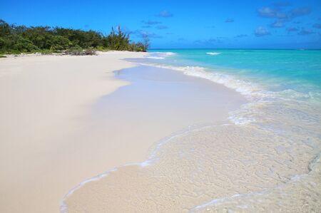 Sandy beach on the shore of Ouvea Lagoon, Mouli Island, Loyalty Islands, New Caledonia.