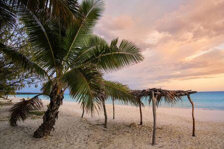 Straw hut at Fayaoue beach at sunrise on the coast of Ouvea lagoon, Mouli and Ouvea Islands, Loyalty Islands, New Caledonia.