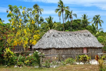 Traditional Kanak house on Ouvea Island,  Loyalty Islands, New Caledonia. Kanak are the indigenous Melanesian inhabitants of New Caledonia.