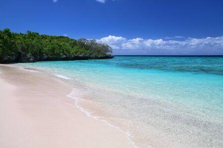 Sandy beach at Gee island in Ouvea lagoon, Loyalty Islands, New Caledonia. Stok Fotoğraf
