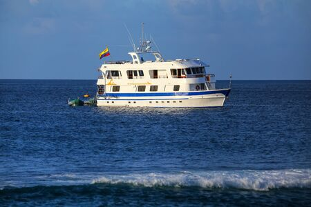 Typical tourist yacht anchored at Suarez Point at Espanola Island, Galapagos National park, Ecuador. More than half the visitors to Galapagos made their tours using boats.
