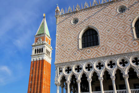 Close view of St Mark's Campanile and Palazzo Ducale at Piazzetta San Marco in Venice, Italy. These buildings are the most recognizable symbols of the city. Stock Photo